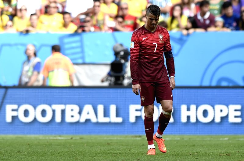 Portugal's Cristiano Ronaldo reacts after a Group G match between Portugal and Ghana of 2014 FIFA World Cup at the Estadio Nacional Stadium in Brasilia, Brazil, ...