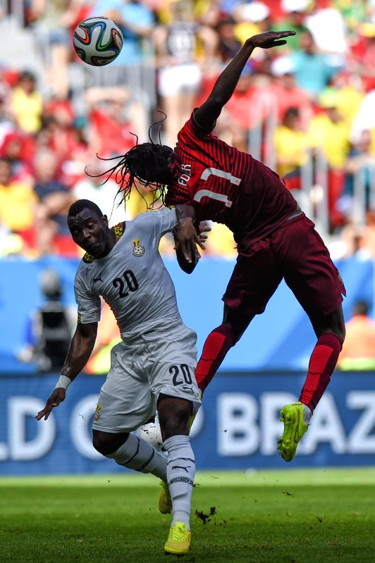 Portugal's Eder (R) vies with Ghana's Kwadwo Asamoah during a Group G match between Portugal and Ghana of 2014 FIFA World Cup at the Estadio Nacional Stadium in ...