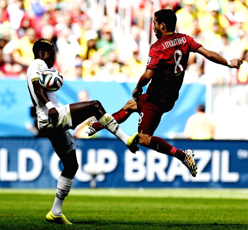 Portugal's Joao Moutinho (R) competes during a Group G match between Portugal and Ghana of 2014 FIFA World Cup at the Estadio Nacional Stadium in Brasilia, Brazil,