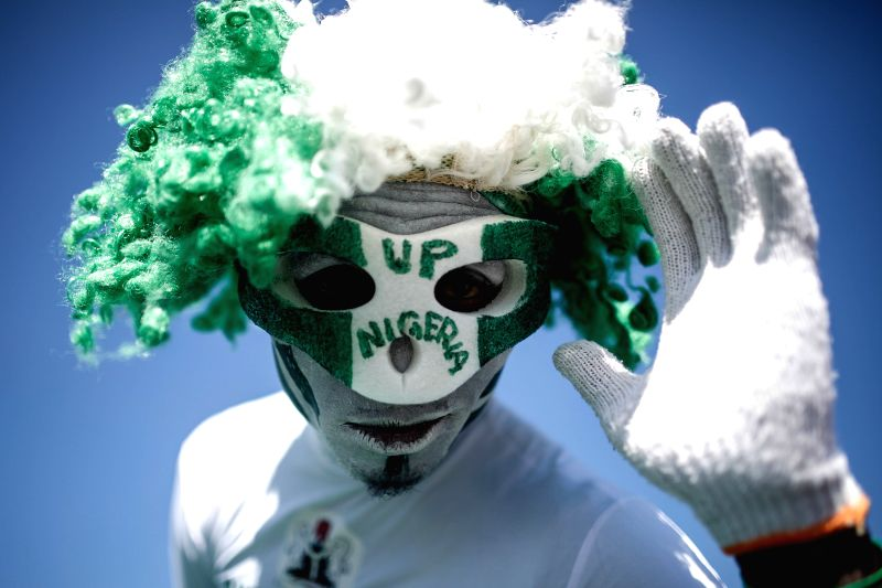 A Nigeria's fan is seen outside the Estadio Nacional Stadium in Brasilia, Brazil, on June 30, 2014, ahead of a Round of 16 match between France and Nigeria of 2014