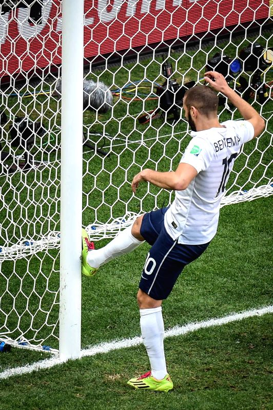 France's Karim Benzema kicks the goalpost during a Round of 16 match between France and Nigeria of 2014 FIFA World Cup at the Estadio Nacional Stadium in Brasilia,