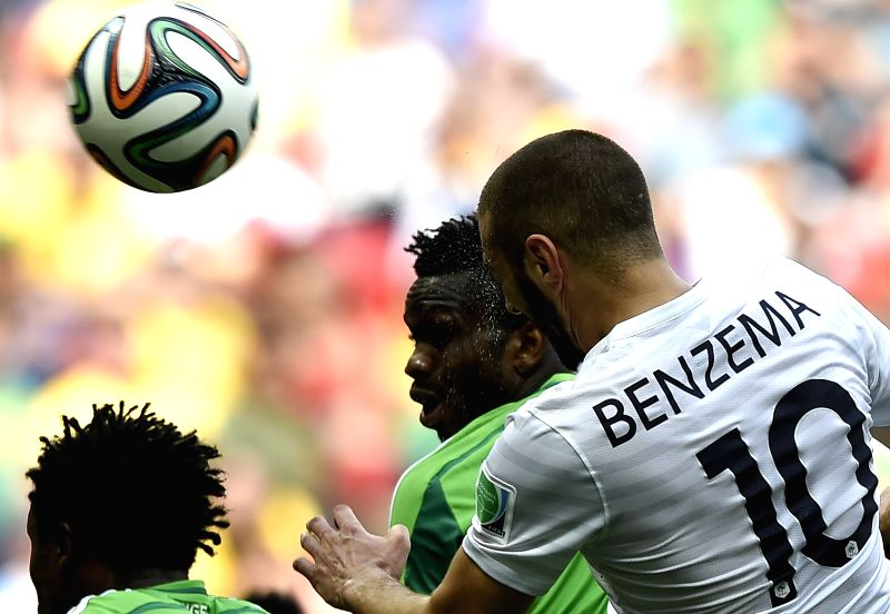 France's Karim Benzema jumps for a header during a Round of 16 match between France and Nigeria of 2014 FIFA World Cup at the Estadio Nacional Stadium in Brasilia,