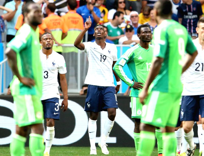 France's Paul Pogba (C) celebrates after scoring a goal during a Round of 16 match between France and Nigeria of 2014 FIFA World Cup at the Estadio Nacional ...