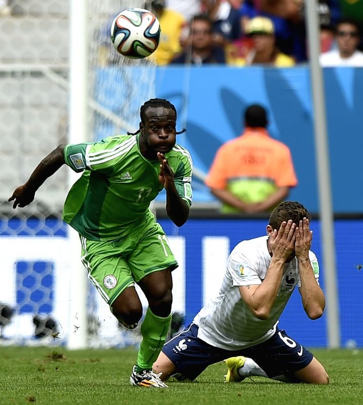 France's Yohan Cabaye vies with Nigeria's Victor Moses during a Round of 16 match between France and Nigeria of 2014 FIFA World Cup at the Estadio Nacional Stadium
