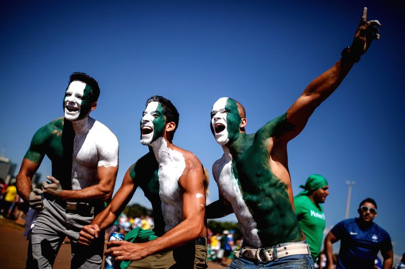 Nigeria's fans pose outside the Estadio Nacional Stadium in Brasilia, Brazil, on June 30, 2014, ahead of a Round of 16 match between France and Nigeria of 2014 ...