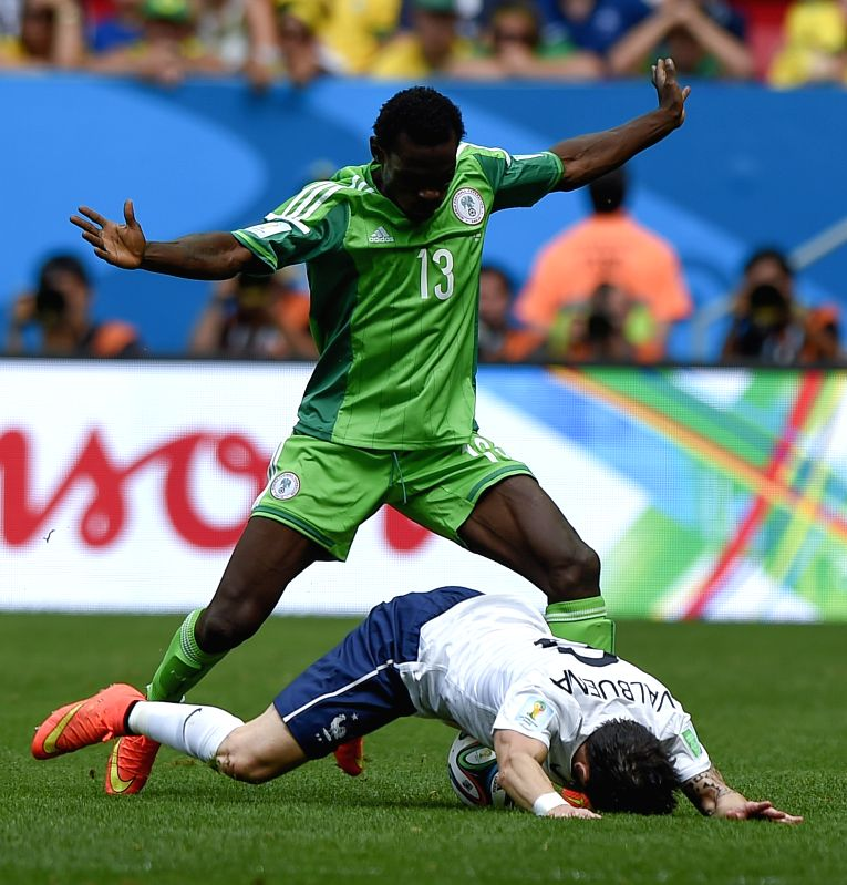 Nigeria's Juwon Oshaniwa (up) vies for the ball during a Round of 16 match between France and Nigeria of 2014 FIFA World Cup at the Estadio Nacional Stadium in ...