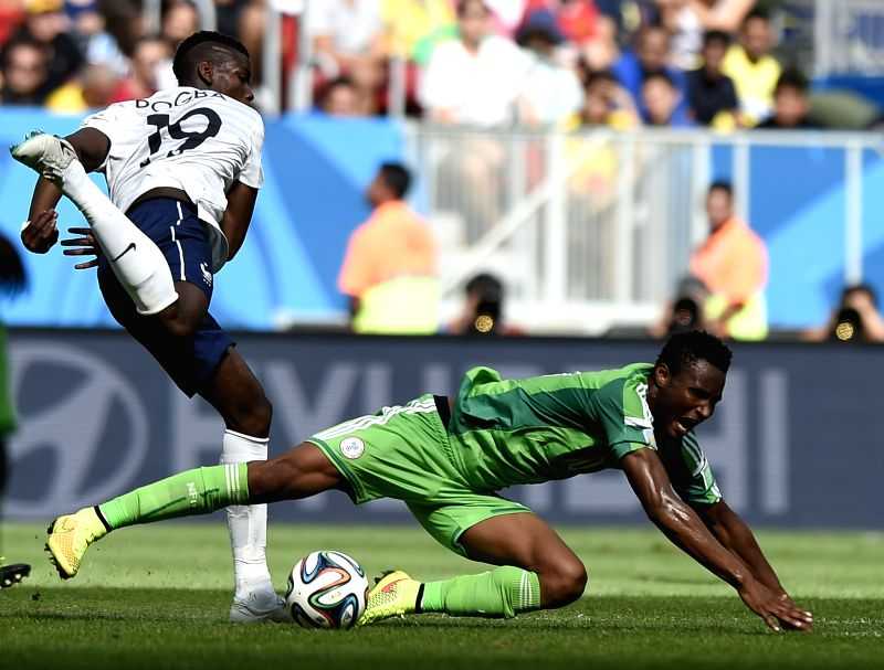 Nigeria's Mikel Obi falls down during a Round of 16 match between France and Nigeria of 2014 FIFA World Cup at the Estadio Nacional Stadium in Brasilia, Brazil, on