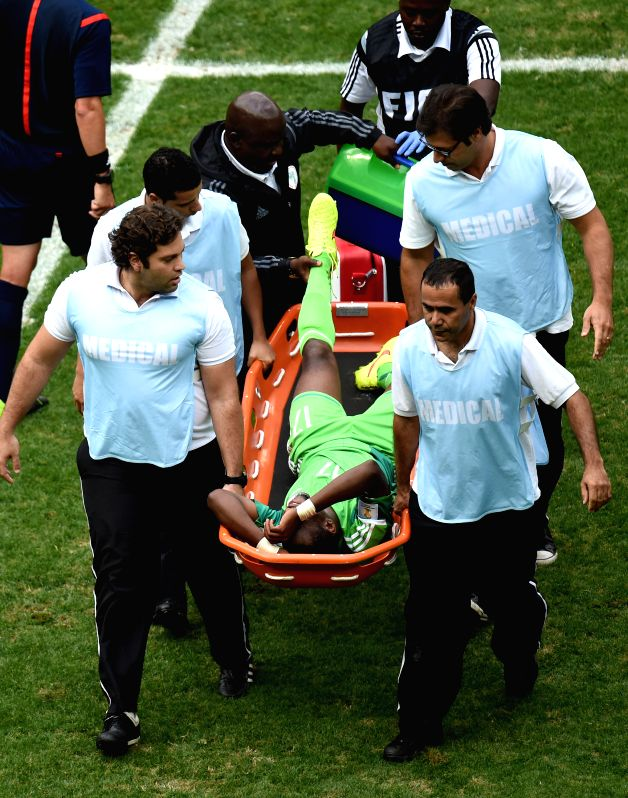 Nigeria's Ogenyi Onazi is carried out of the pitch due to ankle injury during a Round of 16 match between France and Nigeria of 2014 FIFA World Cup at the Estadio .