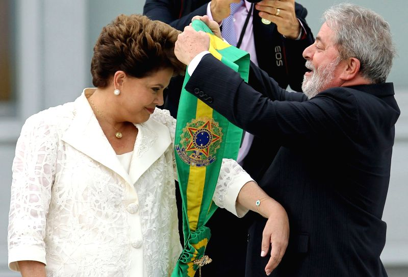 BRASILIA, May 12, 2016 - File photo taken on Jan. 1, 2011 shows Brazilian President Dilma Rousseff (L) receiving the Presidential Band from her predecessor Luiz Inacio Lula da Silva (R) in Brasilia, ...