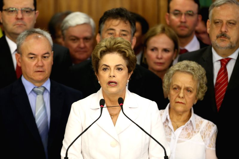 BRASILIA, May 13, 2016 - Brazil's suspended President Dilma Rousseff (C) makes a statement in the Planalto Palace in Brasilia, Brazil, on May 12, 2016. The Brazilian Senate Thursday voted to continue ...
