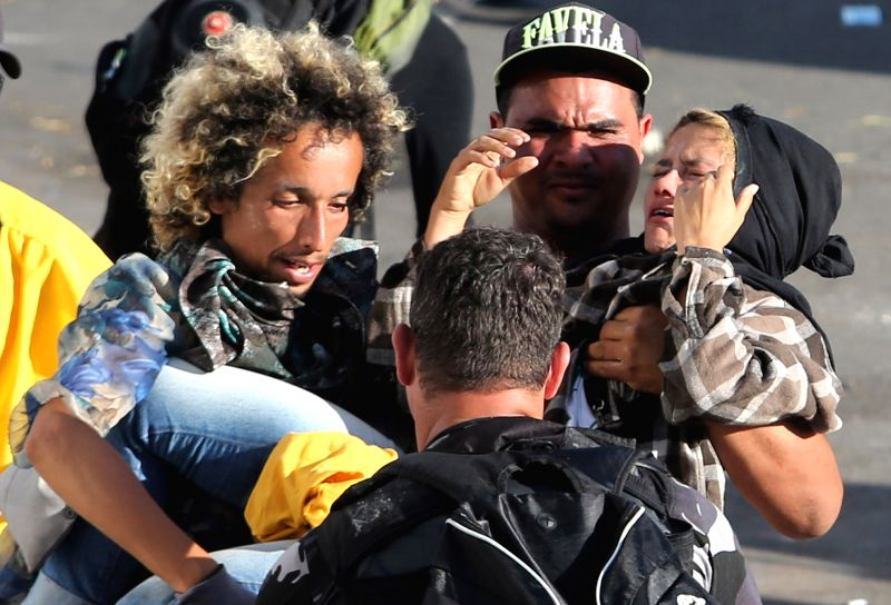BRASILIA, May 25, 2017 - Demonstrators carry a wounded person during a protest in a day known as Occupy Brasilia, in Brasilia, Brazil, on May 24, 2017. Brazil's President Michel Temer ordered ...
