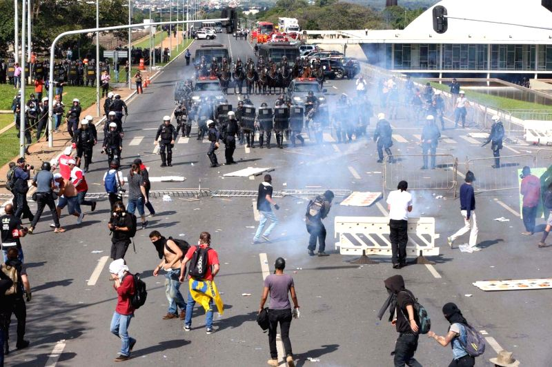 BRASILIA, May 25, 2017 - Demonstrators take part in a clash with members of the security forces, in a day known as Occupy Brasilia, in Brasilia, Brazil, on May 24, 2017. Brazil's President Michel ...