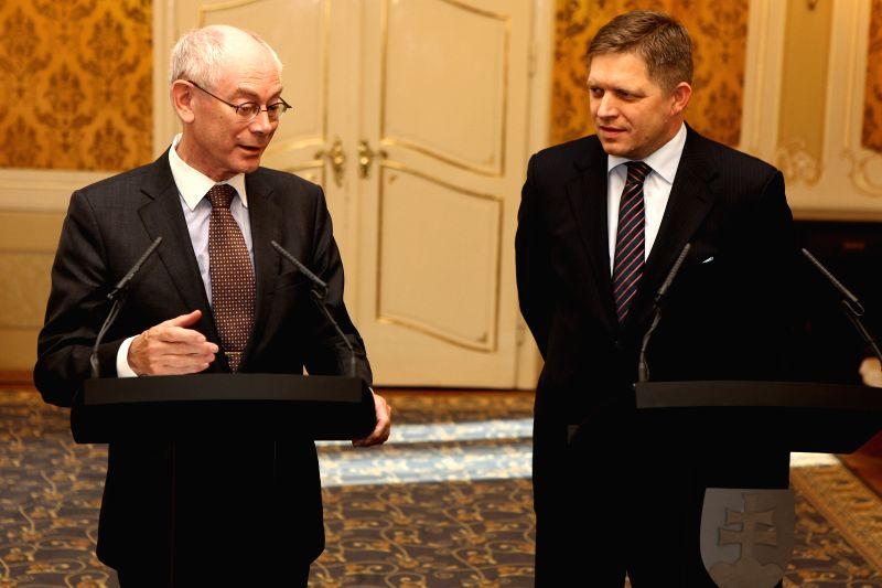 European Council President Herman Van Rompuy (L) and Slovak Prime Minister Robert Fico attend a press conference in Bratislava, Slovakia, April 30, 2014. ...
