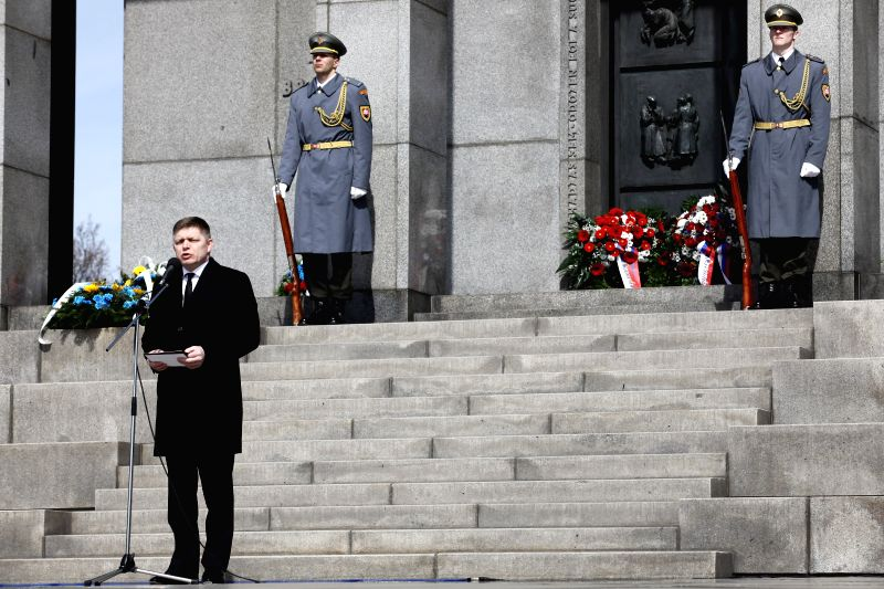 Slovakian Prime Minister Robert Fico delivers a speech during a memorial ceremony to mark the 70th anniversary of the liberation of Slovakia's capital Bratislava ... - Robert Fico