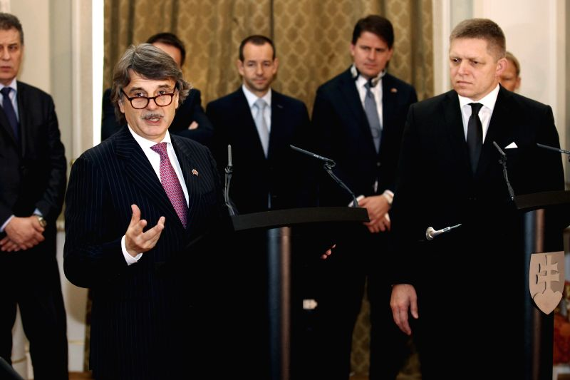 Slovak Prime Minister Robert Fico (R front) and CEO of Jaguar Land Rover Ralf Speth (L front) give statement to journalists after signing an investment contract ... - Robert Fico
