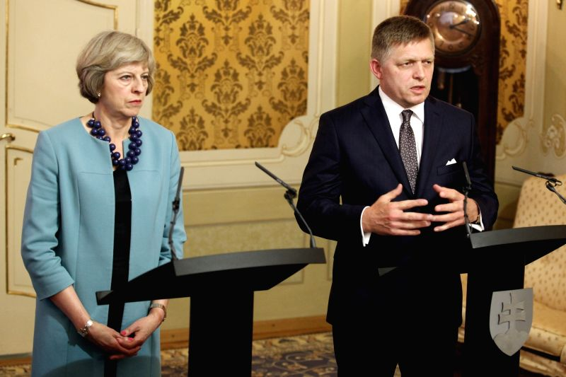 BRATISLAVA, July 28, 2016 - Slovak Prime Minister Robert Fico (R) and his British counterpart Theresa May attend a joint press conference in Bratislava, Slovakia, on July 28, 2016. The notification ... - Robert Fico