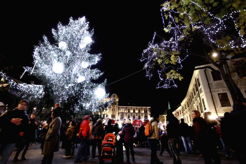 Photo taken on Nov. 21, 2014 shows a general view of a lights-illuminated Christmas fair featuring Slovak products in Bratislava, Slovakia, Nov. 21, 2014. Traditional Slovak foods, ...