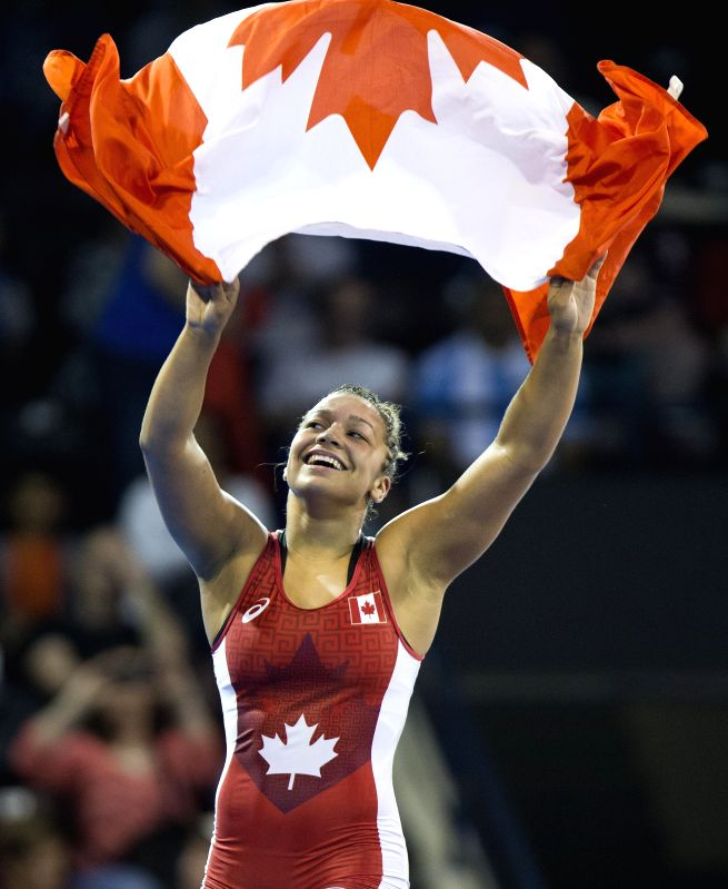 Braxton Stone of Canada celebrates after the women's freestyle 63kg final of wrestling event against Katerina Vidiaux of Cuba at the 17th Pan American Games in ...