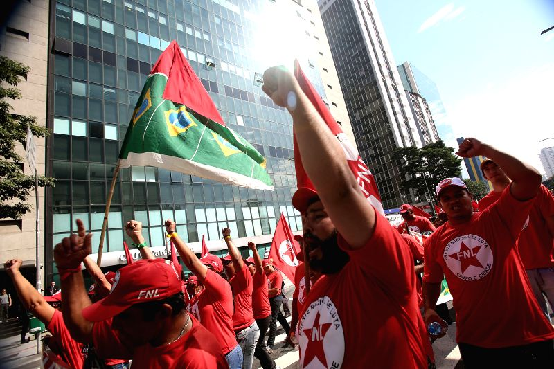 BRAZIL,Protesters attend a demonstration in the street of Sao Paulo, Brazil, on July 3, 2014. Members of social movements such as Landless Workers' Movement ...