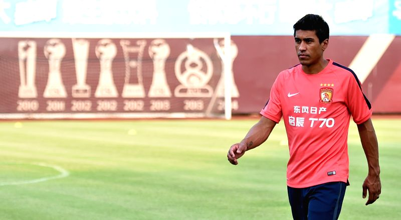 Brazilian football player Jose Paulo Bezerra Maciel Junior (Paulinho) arrives at the training court in Guangzhou, China, July 2, 2015. Paulinho moved from ...