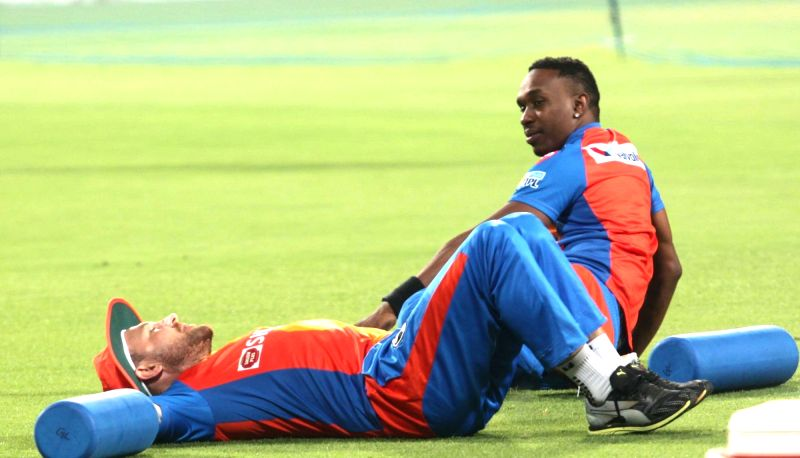 Brendon McCullum and Dwayne Bravo of Gujarat Lions during a practice session in Kolkata on April 20, 2017.