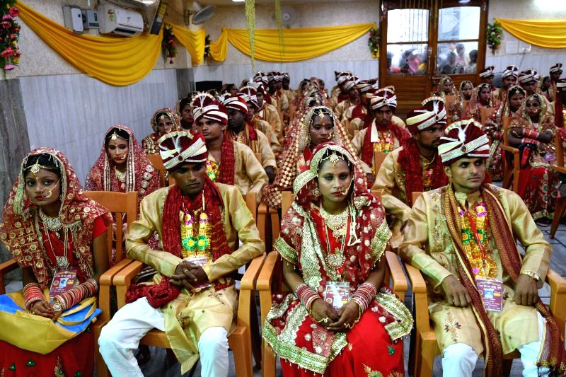 Brides and grooms during a mass marriage ceremony, in Patna on July 15, 2018.