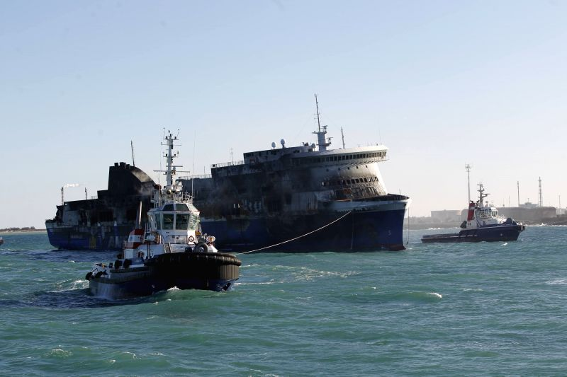 The Italian-owned Norman Atlantic ferry arrives at the port of Brindisi, Italy, on Jan. 2, 2015. Italian prosecutors recovered the black box of the burned-out ...