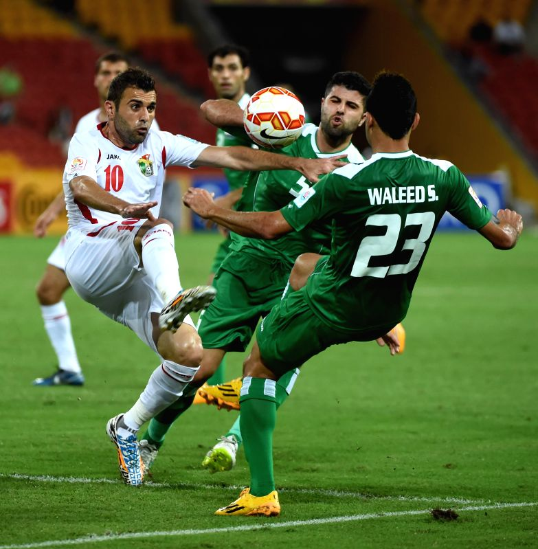 Ahmad Hayel (L) of Jordan vies for the ball during a Group D match against Iraq at the AFC Asian Cup in Brisbane, Australia, Jan. 12, 2015. Iraq won 1-0. ...