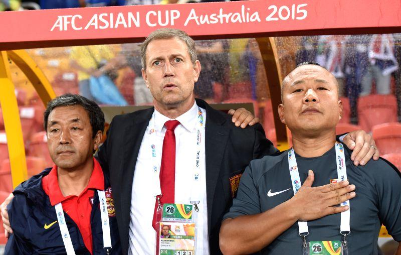 China's head coach Alain Perrin (C) cheer for the team before the quarterfinal match against Australia at the 2015 AFC Asian Cup in Brisbane, Australia, Jan. 22, ...