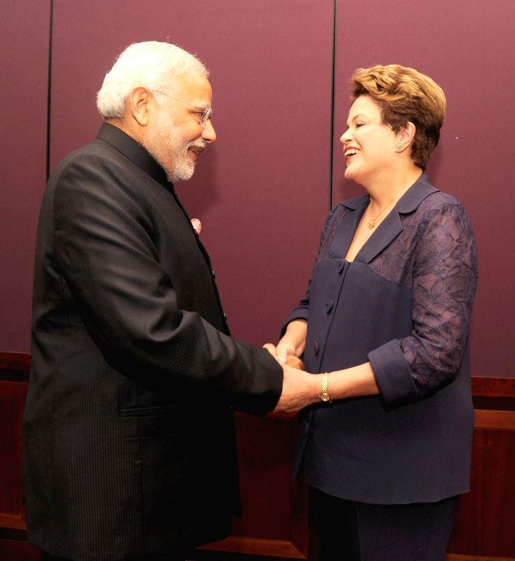 Prime Minister Narendra Modi with the President of Brazil Dilma Rousseff ahead of G-20 Summit, in Brisbane, Australia on Nov. 15, 2014.