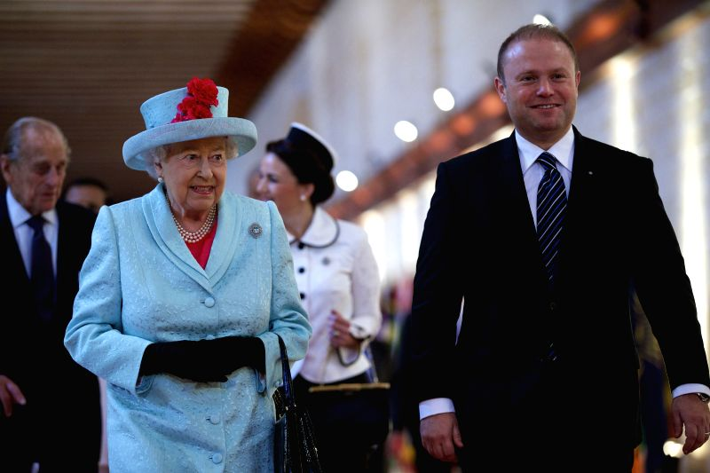 Britain's Queen Elizabeth (L, Front) and Malta's Prime Minister Joseph Muscat (R, Front) arrive for the opening ceremony of the Commonwealth Heads of Government ... - Joseph Muscat