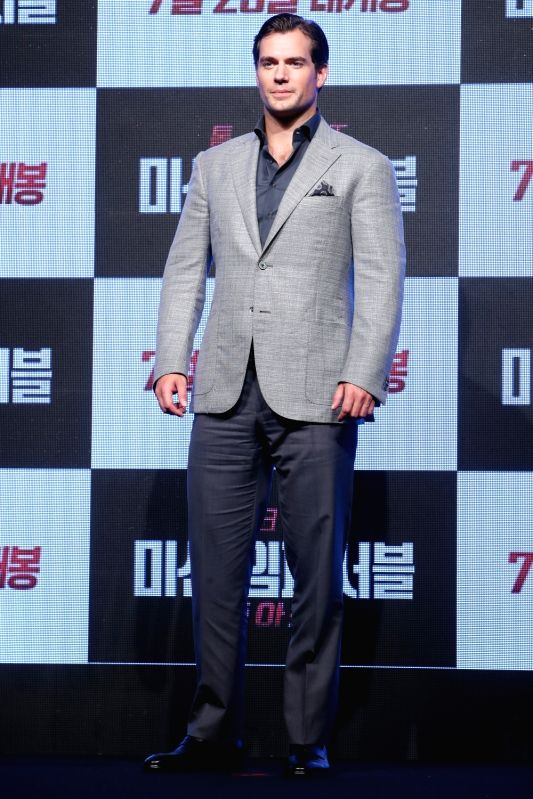 """British actor Henry Cavill poses for a photo during a publicity event in Seoul on July 16, 2018 to promote the 2018 American spy action film, """"Mission: Impossible - Fallout."""" The ... - Henry Cavill"""