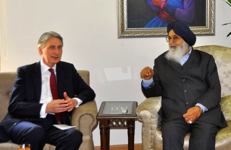 British Foreign Secretary Philip Hammond calls on Punjab Chief Minister  Parkash Singh Badal at his residence Punjab Chief Minister  Parkash Singh Badal in Chandigarh, on March 11, 2015. - Parkash Singh Badal