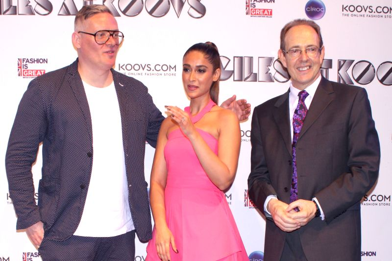 British High Commissioner, James Bevan, designer Giles Deacon and actress Ileana D'Cruz  walk on the ramp at British High Commissioner`s Residence`s, in New Delhi on 23rd April 2015. - Ileana D'Cruz