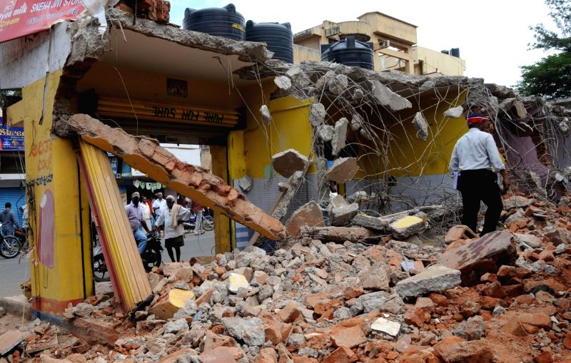 Bruhat Bengaluru Mahanagara Palike (BBMP) officials carry out demolition drive in Bommasandra area of Bengaluru on Aug 10, 2016.