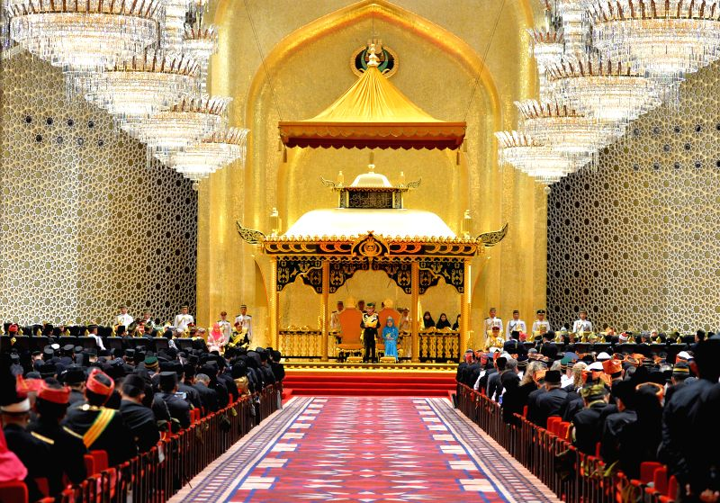 Brunei's Sultan Haji Hassanal Bolkiah (C) gives a speech during his 72nd birthday celebration held at Istana Nurul Iman, the royal palace in Bandar Seri ...