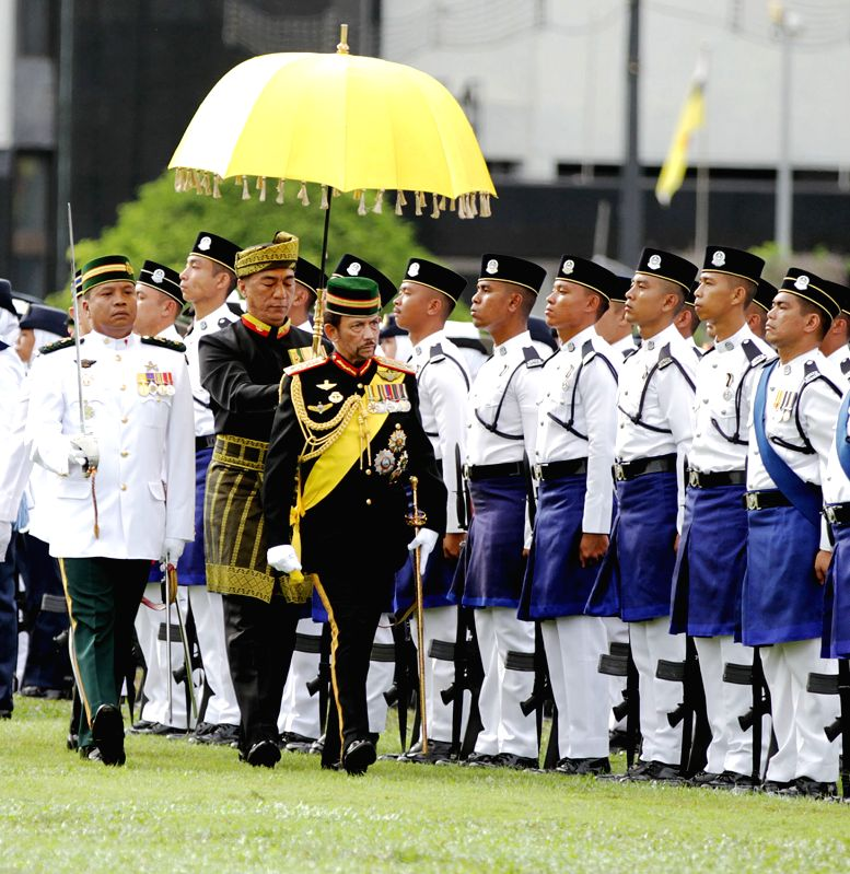 Brunei's Sultan Haji Hassanal Bolkiah inspects the royal guard of honour during a ceremonial parade held for his 72nd birthday celebration in Bandar ...