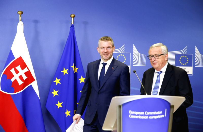 BRUSSELS, April 12, 2018 - European Commission President Jean-Claude Juncker (R) and Slovak Prime Minister Peter Pellegrini attend a press conference after their meeting in Brussels, Belgium, April ... - Peter Pellegrini