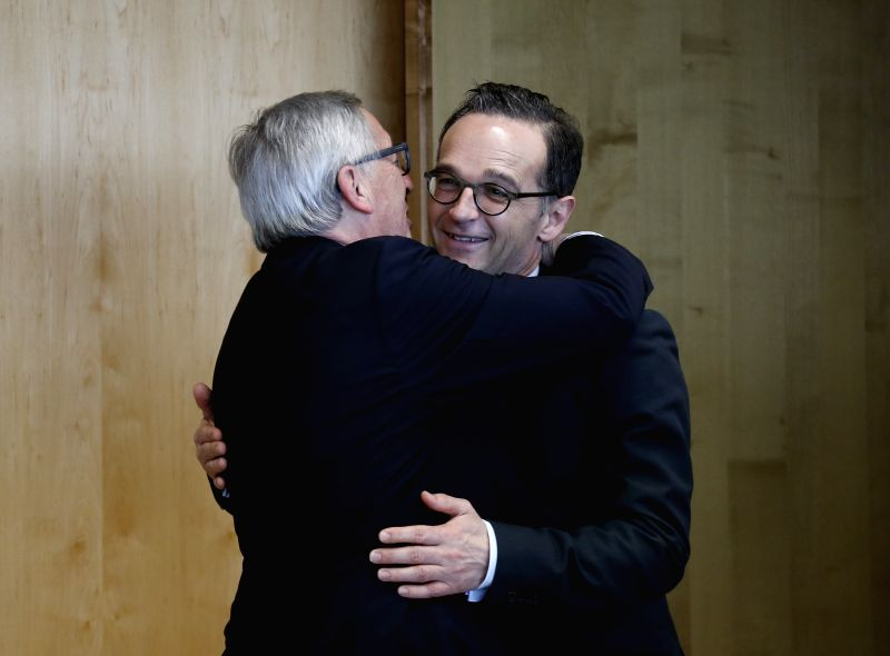 BRUSSELS, April 13, 2018 - European Commission President Jean-Claude Juncker (L) hugs with German Foreign Minister Heiko Maas in Brussels, Belgium, April 13, 2018. - Heiko Maas