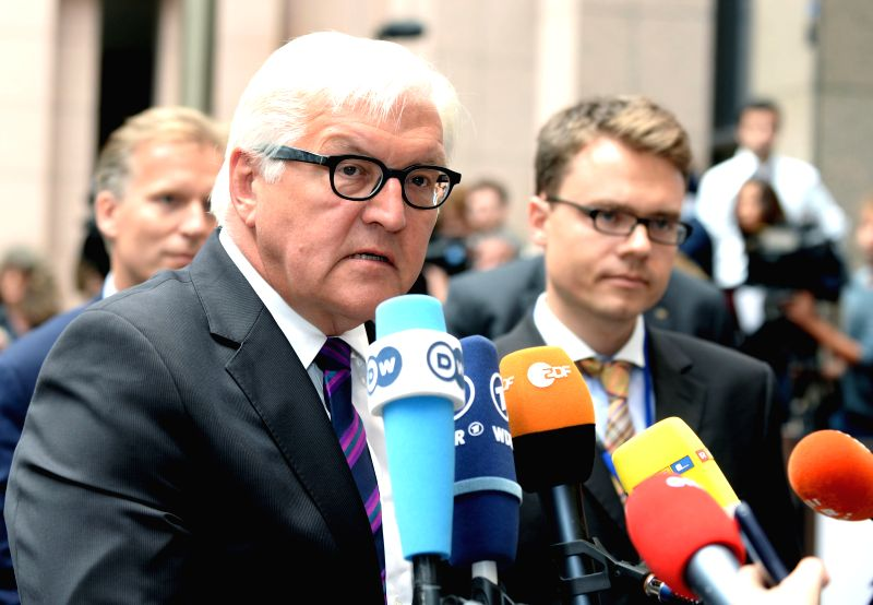 Photo provided by the Council of the European Union (EU) shows German Foreign Minister Frank-Walter Steinmeier speaking to journalists when he attends an emergency