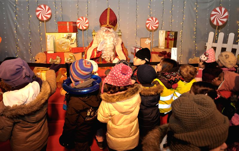 "Children wait to talk with ""Saint Nicolas"" during the Saint Nicolas festival in Brussels, Belgium, Dec. 5, 2014. Saint Nicolas festival traditionally arrives in the Netherlands ..."