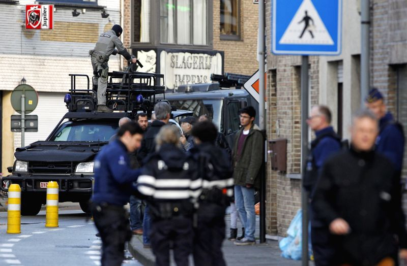 A member of Belgian special forces handles equipments on a vehicle in Ghent, northern Belgium, on Dec. 15, 2014. Belgian police have sealed off part of the ...