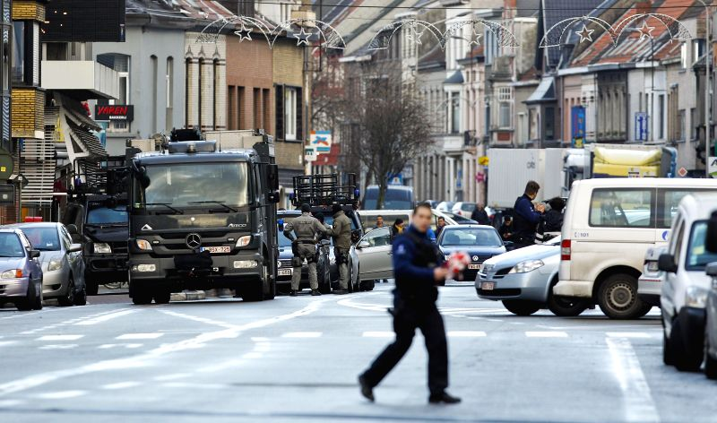 Special policemen handle equipments on a vehicle in Ghent, northern Belgium, on Dec. 15, 2014. Belgian police have sealed off part of the northern Belgian city of .