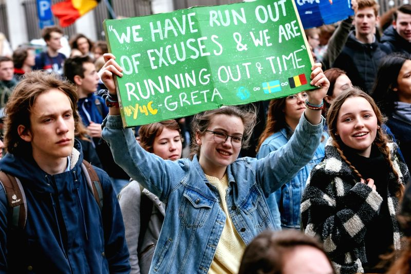 BRUSSELS, Feb. 28, 2019 (Xinhua) -- Students hold placards as they attend a climate march in Brussels, Belgium, on Feb. 28, 2019. A new climate march by schoolchildren and college students was organized across Belgium on Thursday with the participati