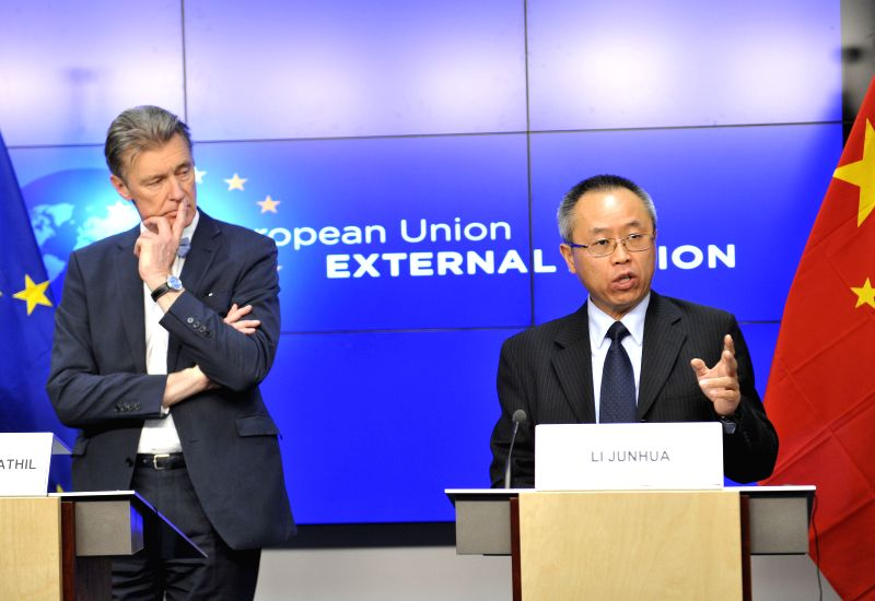 Gerhard Sabathil (L), director for East Asia and the Pacific in the European External Action Service, and Li Junhua, director-general of the Department of International Affairs of the ...