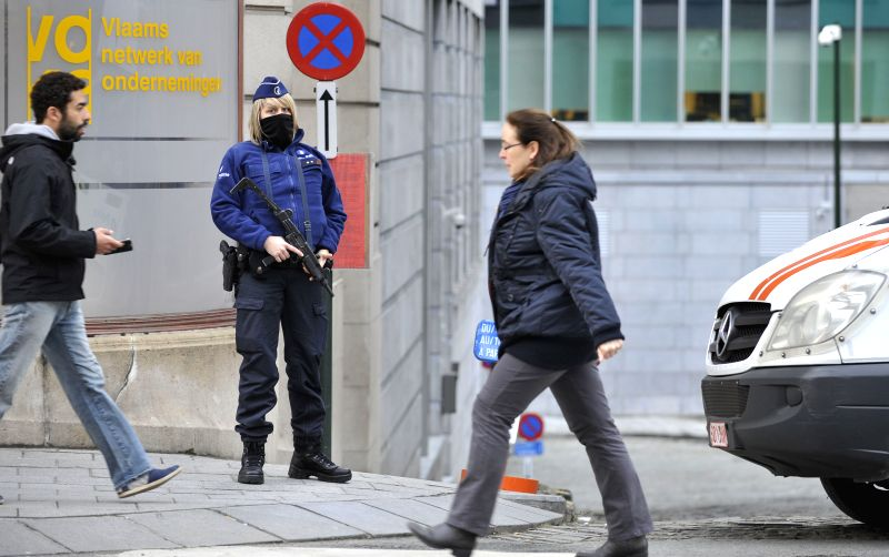 A policewoman guards a street in Brussels, Belgium, Jan. 16, 2015, the day after an anti-terrorism operation took place in Verviers and Brussels. Belgium is on ...