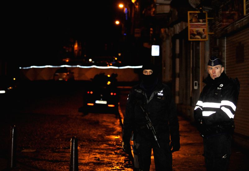 Belgian police block a street in Verviers, a town near Liege, in the eastern Belgium, Jan. 16, 2015. Two people have been killed in an anti-terrorism operation ...