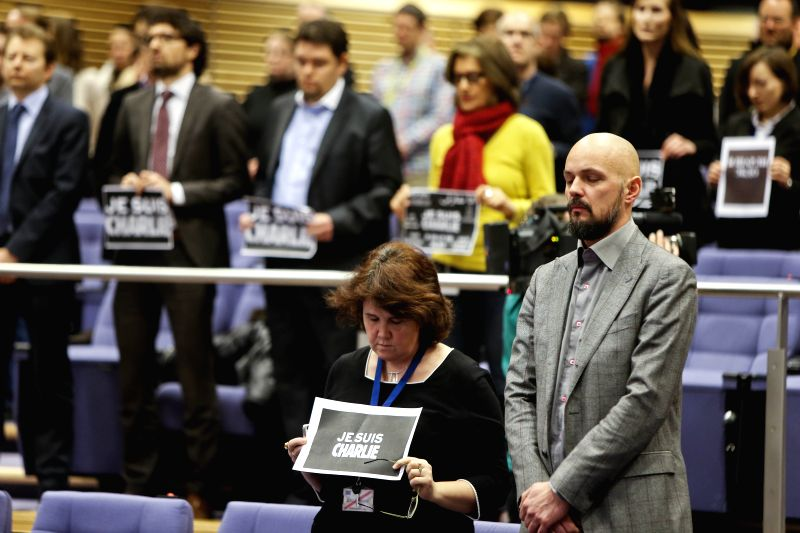 Staff of the European Commission attend the minute of silence in the European Commission building in Brussels, Belgium, on Jan. 8, 2015, commemorating the victims ..