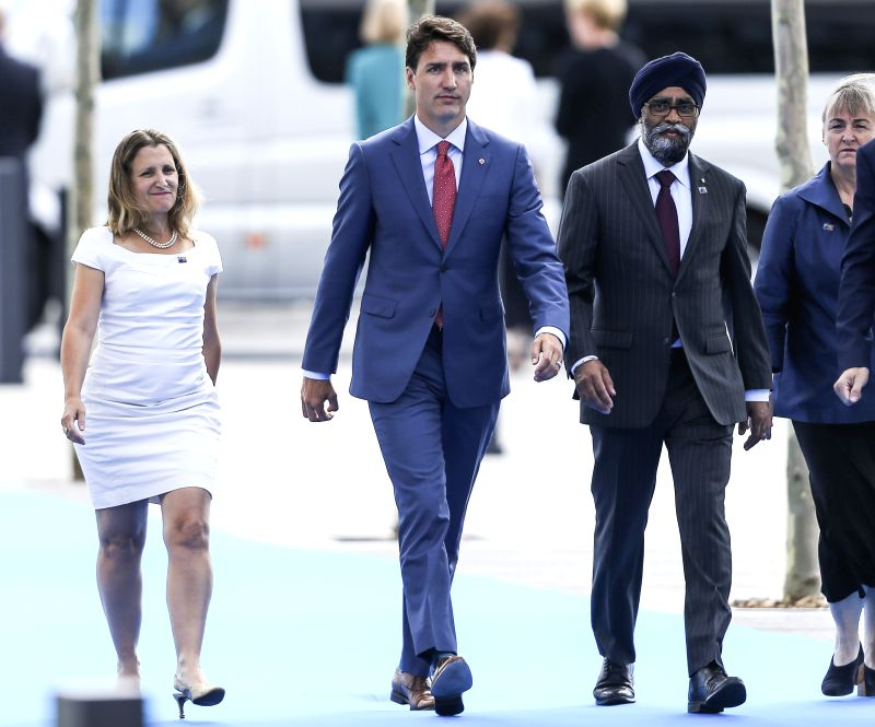 BRUSSELS, July 11, 2018 - Canadian Prime Minister Justin Trudeau (C) arrives at a NATO summit in Brussels, Belgium, July 11, 2018. NATO leaders gather in Brussels for a two-day meeting. - Justin Trudeau