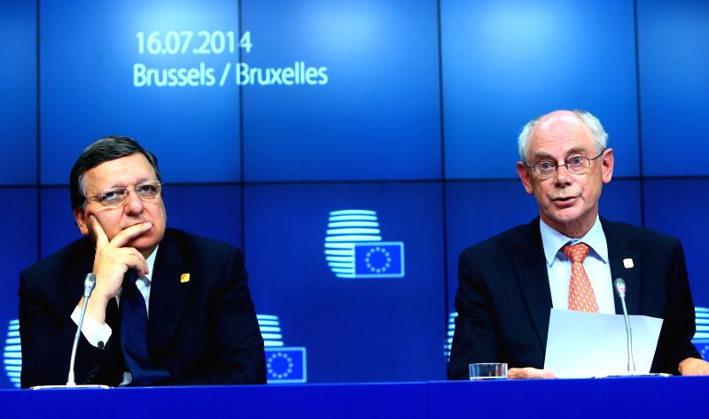 European Commission President Jose Manuel Barroso (L) and European Council President Herman Van Rompuy attend a press conference after a special meeting of the ...